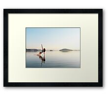 Woman practicing Hatha yoga on a platform in the water Triangle pose art photo print Framed Print