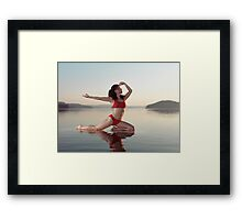 Woman practicing yoga on platform in the water doing Pigeon pose variation art photo print Framed Print