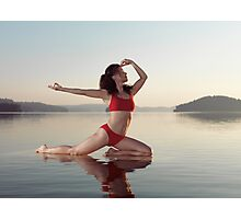 Woman practicing yoga on platform in the water doing Pigeon pose variation art photo print Photographic Print