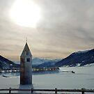 Church-tower in frozen lake by Arie Koene