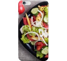Top view of a small plate of salad made from natural raw vegetables iPhone Case/Skin