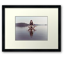 Woman practicing still sitting meditating on platform in the water art photo print Framed Print