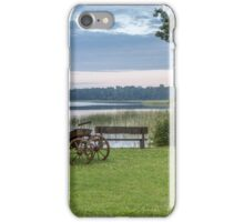 Old carriage standing near the lake iPhone Case/Skin