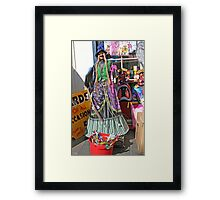 Halloween witch outside a shop Framed Print