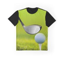 Golf ball and driver on green grass Graphic T-Shirt