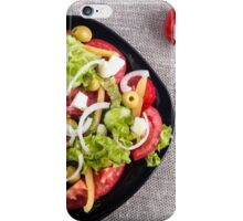 Top view of a small bowl of salad from natural raw vegetables iPhone Case/Skin