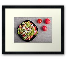 Top view of a small bowl of salad from natural raw vegetables Framed Print