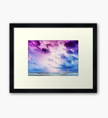 Cloudy shores Framed Print