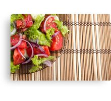 Closeup view on a fragment of a plate with fresh salad of raw tomatoes Canvas Print