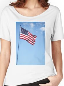 United states of America flag blowing in the wind with clouds and blue sky background Women's Relaxed Fit T-Shirt