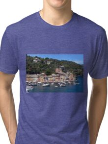 Photography of the beautiful Portofino fishing village in Italy. Aerial view on small bay and colorful houses at town of Portofino in Liguria, Italy. Tri-blend T-Shirt