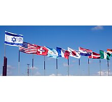 a row of 10 flags waving Photographic Print