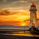 Sunset At The Lighthouse by Adrian Evans