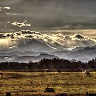 Sunset Along the Front Range by Roger Passman