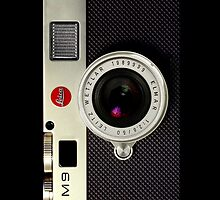 Vintage Classic retro Silver leica m9 camera by Johnny Sunardi