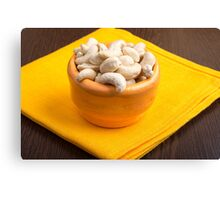 Selective focus on raw cashew nuts closeup Canvas Print