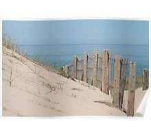Sand dunes and weathered fence at the beach Poster