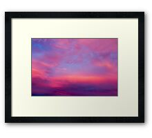 Dramatic red cloudscape at sunset.  Framed Print