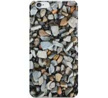 Pebbles and rocks on the shore of a river iPhone Case/Skin