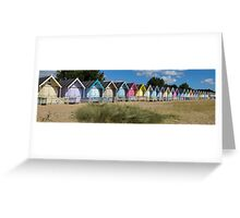 Panoramic of a row of beach huts at West Mersea, Essex Greeting Card
