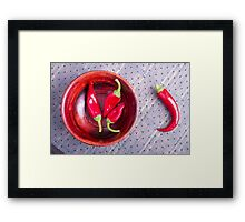Red raw pepper in a brown wooden bowl Framed Print