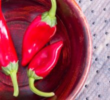Red raw pepper in a brown wooden bowl Sticker