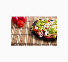 Closeup view fresh natural salad with raw tomato, cucumber, olives, onion, lettuce Unisex T-Shirt