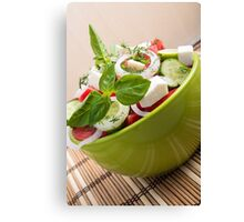 Vertical view close-up on a green bowl with a salad Canvas Print
