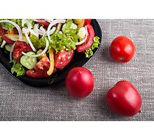 Fresh tomatoes and a part of a plate with vegetarian salad Photographic Print