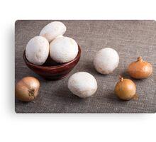 Raw champignon mushrooms and onions Canvas Print