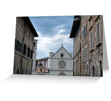 Buildings from Assisi leading to a white church. Greeting Card