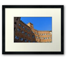 Building red brick facade from Piazza del Campo, Siena. Framed Print