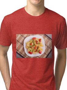 Top view of the pieces of potato stew with vegetables Tri-blend T-Shirt