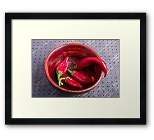 Hot red chili peppers on a fabric background Framed Print