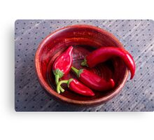 Hot red chili peppers on a fabric background Canvas Print