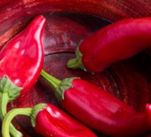 Hot red chili peppers on a fabric background Sticker