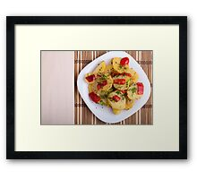 Top view of the pieces of potato stew with vegetables Framed Print