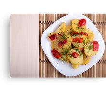 Top view of the pieces of potato stew with vegetables Canvas Print