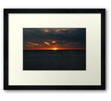 sunset on the beach Framed Print