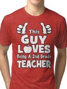 This Guy Loves Being A 2nd Grade Teacher Tri-blend T-Shirt