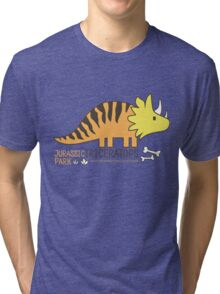 Dinosaurs, Jurassic Park. Adorable seamless pattern with funny dinosaurs in cartoon Tri-blend T-Shirt