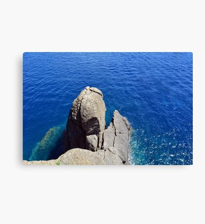 The blue sea and rocky formations Canvas Print