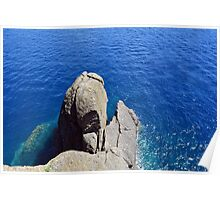 The blue sea and rocky formations Poster