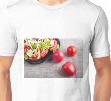Close-Up top view on fresh tomatoes and a bowl of vegetarian salad Unisex T-Shirt
