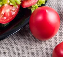 Close-Up top view on fresh tomatoes and a bowl of vegetarian salad Sticker