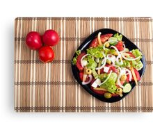 Top view on a vegetable salad with natural ingredients Canvas Print