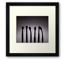Silhouettes of burnt matches on vignetting background Framed Print
