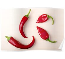Hot red chili peppers on a light wooden board Poster