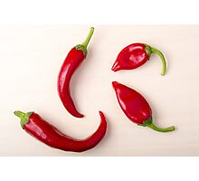 Hot red chili peppers on a light wooden board Photographic Print