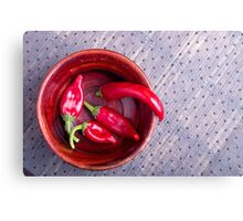 Top view of the fruits of of hot red chili peppers Canvas Print
